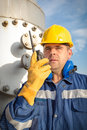 System operator in oil and gas production with yelow helmet Stock Photos