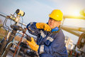 System operator in oil and gas production with yelow helmet Royalty Free Stock Images