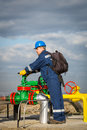 System operator in oil and gas production with yelow helmet Stock Image