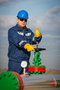 System operator in oil and gas production with yelow helmet Stock Photo