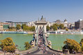 Szechenyi Bridge in Budapest on a holiday and people walking on the bridge, Royalty Free Stock Photo