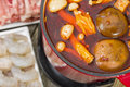 Szechuan hot pot spicy chinese with beef tofu prawns and mushrooms Royalty Free Stock Image
