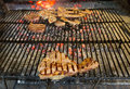 T bone steak on grill and fire shallow depth of field Royalty Free Stock Photography
