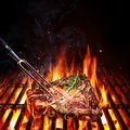 T-Bone Steak - Porterhouse On Grill Royalty Free Stock Photo