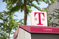 T online hotspot for wireless internet offered by the german telekom on top of one of their phone booths focus is on the moniker Stock Photos