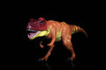 T rex tyrannosaurus dinosaur toy figure against black background Royalty Free Stock Photo