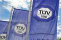 Tüv süd flags of the against a nice cloudy sky Royalty Free Stock Photo
