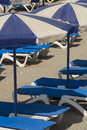 Tabarca beach sunlounger and parasol on island alicante spain Stock Photos