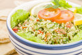 Tabbouleh arabic salad made with bulghur wheat tomato cucumber onions parsley and min and seasoned with lemon juice and olive oil Royalty Free Stock Photo