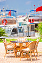 Table against the background of yacht harbor Royalty Free Stock Image