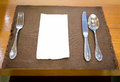 Table appointments (fork,knife,spoon, silk napkin) Royalty Free Stock Photo