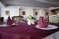 Table arrangement a in a hotel with burgundy tablecloth and napkins Stock Photography