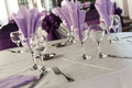 Table arrangement a with purple napkins Royalty Free Stock Photography