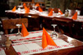 Table arrangement with red napkins a in a rustic restaurant Royalty Free Stock Photography