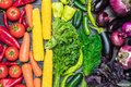 A table arrangement of a variety of fresh fruits and vegetables sorted by colors Royalty Free Stock Photo