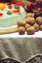 Table arrangement walnuts cherry cake