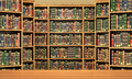 Table on background of bookshelf full of books . Royalty Free Stock Photo
