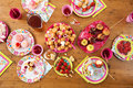Table with birthday treats Royalty Free Stock Photo