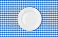 Table with blue picnic cloth and plate top view tablecloth Stock Images