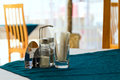 Table in a cafe with salt pepper and toothpicks Royalty Free Stock Images