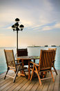 Table and chairs beautiful arrangement of on the ocean side Royalty Free Stock Photo