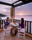 Table and chairs with breakfast during sunrise at the meditarian sea in Greece Royalty Free Stock Photo