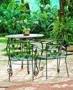 Table with chairs in the garden Royalty Free Stock Photo