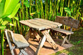 Table with chairs in the garden wood on block floor Royalty Free Stock Photos