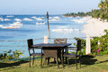 Table and chairs next to the sea in island panglao philippines Stock Images