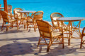 Table and chairs by the pool Royalty Free Stock Photography
