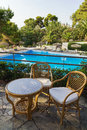 Table and chairs for rest overlooking the pool in hotel territory Royalty Free Stock Image