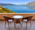 Table and chairs on a terrace, view on a lake Royalty Free Stock Photo