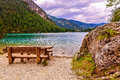 Table and chairs to admire the lake view Royalty Free Stock Photo
