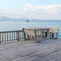 Table and chairs on a tropical beach resort wooden Royalty Free Stock Photos
