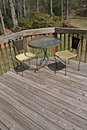 Table And Chairs On Wood Deck Royalty Free Stock Photography