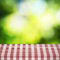 Table cloth on table and bamboo background Royalty Free Stock Image