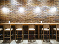 Table counter Bar with Chairs and Lights Brick wall background Royalty Free Stock Photo
