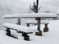 Table covered by snow into the park Royalty Free Stock Photography