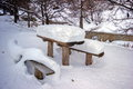 A table covered with snow the is on river bank kiasarovka summer in this place people relax Stock Photography