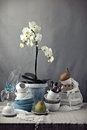 Table with dishes and white orchid rustic Royalty Free Stock Photography