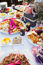 Table filled with delicious bread pates jams and other condime condiments at a wedding reception Royalty Free Stock Photo