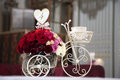 Table flower ornament a in a white tricycle Stock Photo