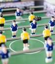 Table football game with yellow and blue players Royalty Free Stock Photo