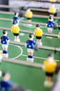 Table football game with yellow and blue players Royalty Free Stock Image