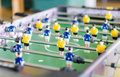 Table football game with yellow and blue players Royalty Free Stock Photography