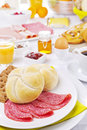 Table full with continental breakfast items, brightly lit Royalty Free Stock Photo