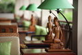 Table lamp with sculpture of women in the green lamp carving Stock Photography