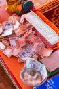 Table with money for making merit Inside Guru Rinpoche Temple at Namchi. Sikkim, India Royalty Free Stock Photo