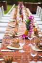 Table for an outdoor event in a tropical location Royalty Free Stock Photo
