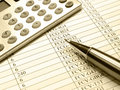 Table, pen and calculator (sepia) Royalty Free Stock Photo